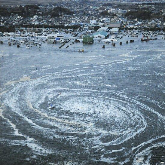Tsunami swirls near a port in Oarai