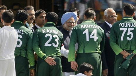 Indian Prime Minister Manmohan Singh, centre back, and Pakistan Prime Minister Yousuf Raza Gilani, fourth from left at back, shake hands with Pakistan players ahead of the Cricket World Cup semi-final match between India and Pakistan in Mohali, India, Wednesday, March 30, 2011.