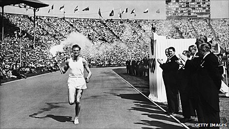 John Mark runs in the Empire Stadium, Wembley, with the torch