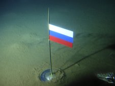Russian flag on sea bed under North Pole
