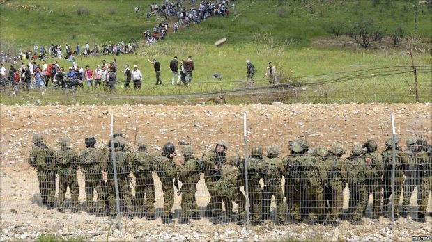 Israeli soldiers confront protesters near the northern Druze village of Majdal Shams in the Golan Heights