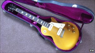 This 1954 Goldtop guitar, played by Carl Perkins on the classic record Blue Suede Shoes, was sold at auction in the UK for just under 6000 (appx. $9795).