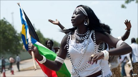 Women from a cultural dance troupe parade through Juba, the capital of soon-to-be independent South Sudan, on July 8, 2011,