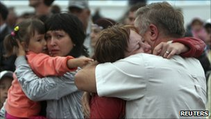 Tearful reunions of survivors of the tragedy and their loved ones at the port of Kazan in Russia on Sunday