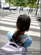 Lone girl at zebra crossing