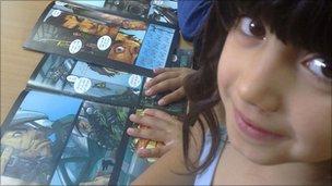 Jordanian girl reading a comic