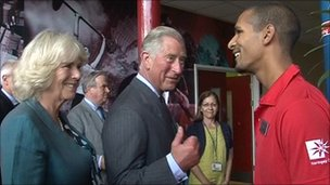 Duchess of Cornwall and Prince of Wales speak to worker at Tottenham Leisure Centre on 17 August 2011