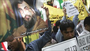 Iranian students hold placard of Hezbollah leader Hassan Nasrallah during protest against Israeli offensive against Lebanon in 2006