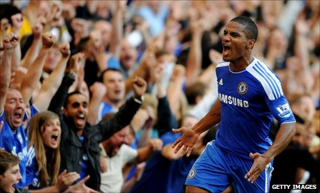 Malouda celebrates after scoring the winner at Stamford Bridge