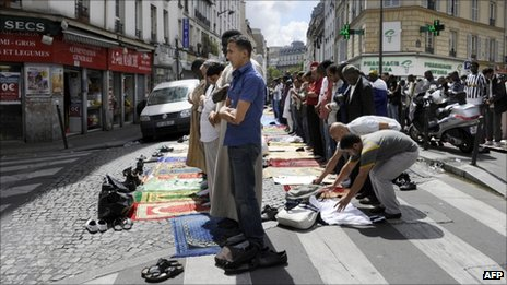 Muslims pray in a Paris street, 5 August 2011