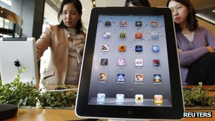 Customers look at the iPad 2 in South Korea
