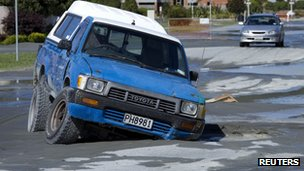 Vehicle trapped in pothole caused by liquefaction