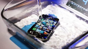 An iPhone submerged in water