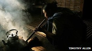 A Khasi woman cooking