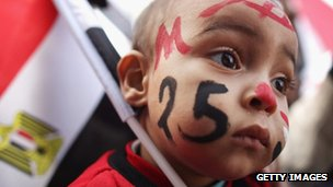 A baby wearing face paint in Tahrir Square, Cairo (25 Jan 2012)