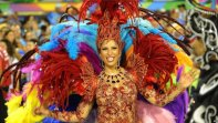 A reveller of Renascer samba school dances during the first night of the carnival parade at the Sambadrome
