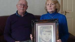 Billy and Pat Gallagher with a picture of their nine-year-old son Gordon
