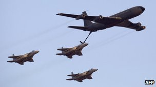 Israeli F-15 fighter jets refuel during an air show at the graduation ceremony of Israeli pilots in the Hatzerim air force base in the Negev desert near the southern Israeli city of Beersheva on June 30, 2011