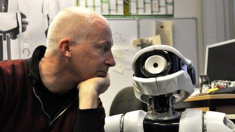 Prof Marcus du Sautoy and a robot