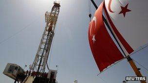 Turkish and Turkish Cypriot flags next to a drilling tower in northern Cyprus