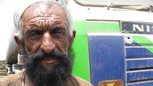 Muhammed Baqi beside the Nato oil tanker his nephew drove