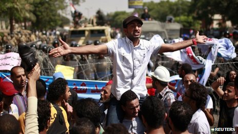 Protesters react outside the Supreme Constitutional Court in Cairo June 14, 2012