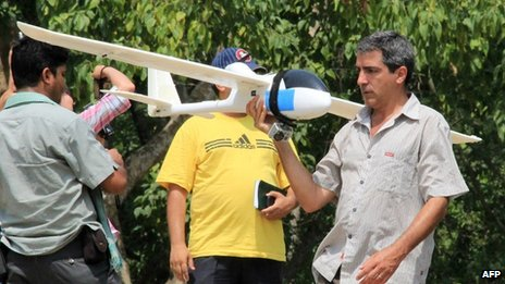 Handout photograph from the World Wildlife Fund (WWF) Nepal showing conservationists from the WWF testing an automated drone aircraft in Chitwan National Park on June 12, 2012.