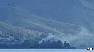Smoke rises from the hotel near Kabul. Photo: 22 June 2012