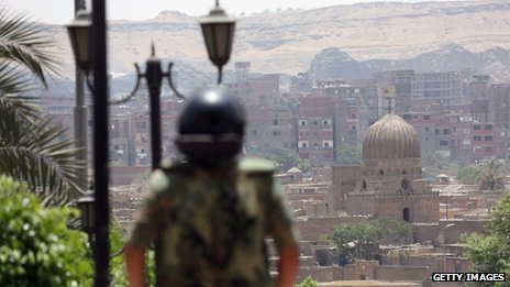 An Egyptian soldier looks out over Cairo during presidential election - 24 May 2012