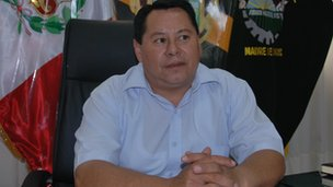 Peruvian politician in his office