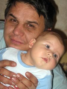 Policeman Marat Khisamutdinov with baby son Timofei