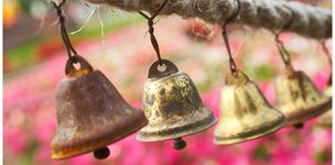 Hand bells hanging from rope