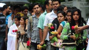 "Bangladeshi youth wait in line to pay their last respects to the country""s most popular fiction writer, Humayun Ahmed in Dhaka on July 23, 2012."