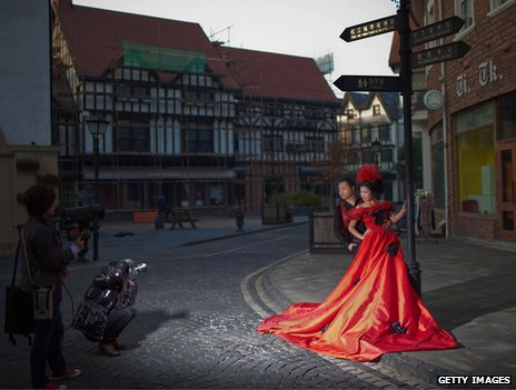Chinese newlyweds pose for wedding photographs in Thames Town, Songjiang, China, 19 November 2010