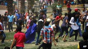 Egyptian women are harassed by a large crowd of men and boys in a park in Cairo. Photo: August 2012