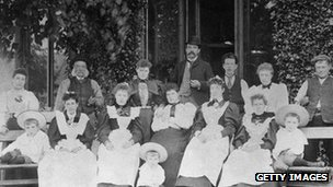 The owners of a large Victorian house and their servants, circa 1885.