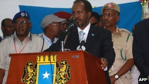 "Somalia""s newly elected President Hassan Sheikh Mohamud (C) delivers a speech on September 10, 2012 in Mogadishu"