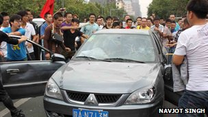 Protesters in the city of Xi'an set upon a Japanese-made car