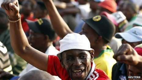 Striking miners gesture after they were informed of a 22 percent wage increase offer outside Lonmin's Marikana mine, 100 km (60 miles) northwest of Johannesburg, September 18, 2012