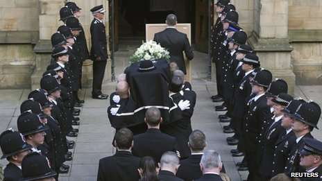Police officers formed a guard of honour at Manchester Cathedral