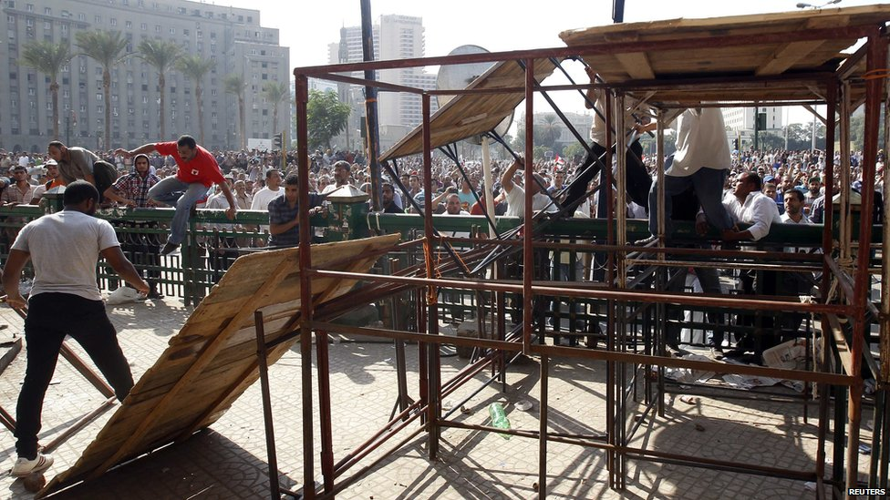 Pro-Mursi protesters storm the stage in Tahrir Square
