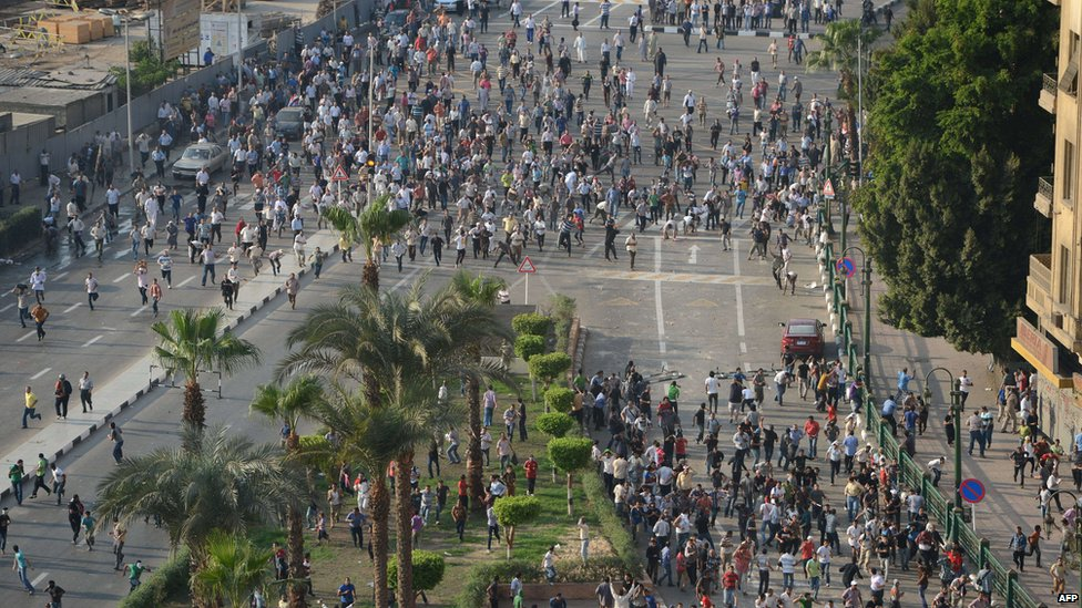 Protesters fight in Tahrir Square. 12 Oct 2012
