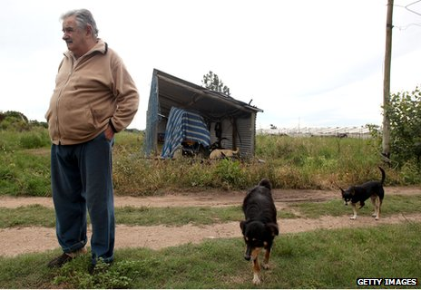 Jose Mujica and his dogs outside his home
