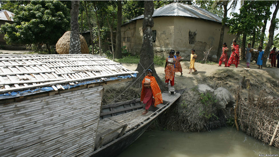 Children board a floating school