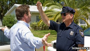 Stock photo of a police officer performing a field sobriety test