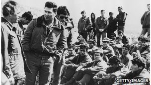 Defence Minister Shimon Peres (left) addresses Israeli commandoes after the raid on Entebbe in 1976