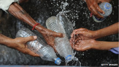 People filling up water bottles from a water tanker in New Delhi