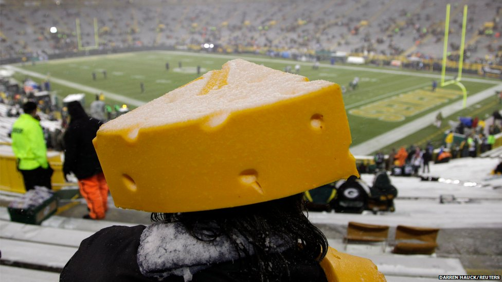 A fan with a cheese-shaped hat