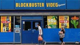 People walk past Blockbusters store (file photo 2010)