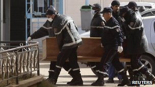Rescue workers carry the coffin of one of the hostages killed during a hostage crisis in a gas plant at the hospital in In Amenas, 21 January 2013.